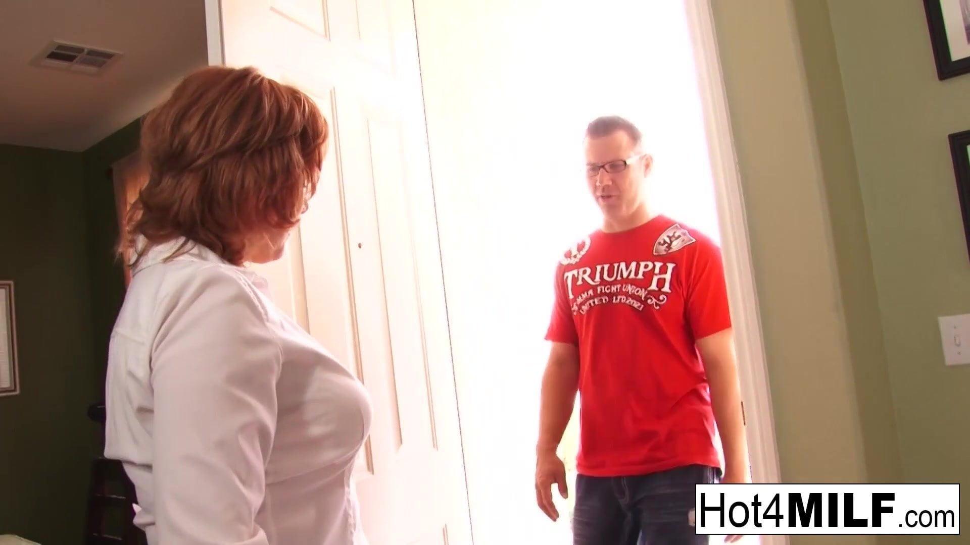 .Sexy redheaded MILF gets cum on her big tits.