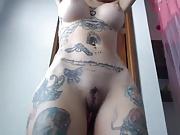fake-breasted tattooed latin cam-slut
