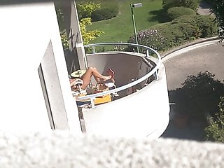 Spy candid neighbour on balcony