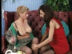 Old german mom having fun with a cute young girl