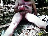 Masturbating outside in the woods.