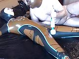 Latex Danielle is attached to the bed and masturbated with t