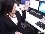 Asian office worker with stockings rubs her pussy with a sex