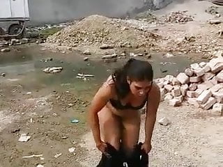 Outdoor Brunette Milf video: Pakistani woman taking off her clothes