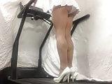Pleated skirt pantyhose walk.