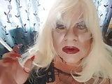 transvestite smoking long nails red lips