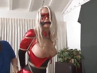 Red Superheroine in Bondageand humiliated