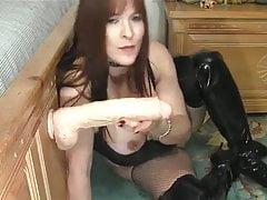 Horny chick plays with a big white dildo.