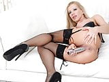 Big titted Italian milf Lara De Santis toying her pussy