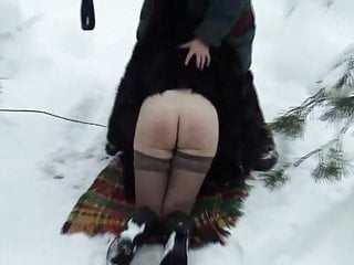 Spanking video: Woman in fur coat spanked in snow