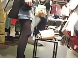 Attractive shopper in shiny black pantyhose