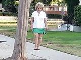 Candid street granny in short skirt