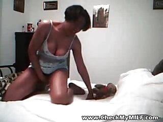 .Check My MILF Black mom with saggy tits riding white dildo.