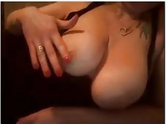 Spycam: pretty milf tatooed  flashing her tits