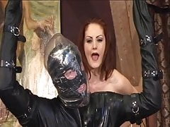 Dominatrix fucks this bound gimp in the face