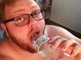 Chubby Guy Sucks Bottle and Masturbates on His Knees