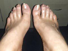 Geölte glitzernde Füße