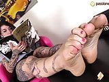 Barefoot Tattoed girl shows off her sexy feet