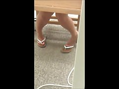 Two cute girls' feet at library