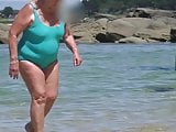 beautiful sexy granny in the wet turquoise swimsuit