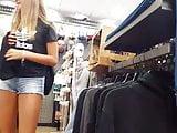 Candid voyeur blonde teen shorts tan legs