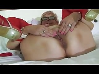 Masturbation Grannies Stockings video: Sexy Granny In Red Lingerie Masturbates In Bed