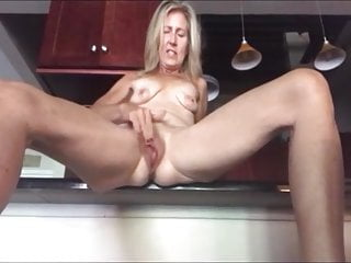 milf kitchen Blonde the masturbating cum in and
