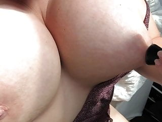 Busty slut plays with nipple suckers...