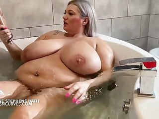 Busty british milf reads mag bath...
