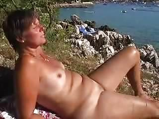 Recording hot wife vacation beach naked...