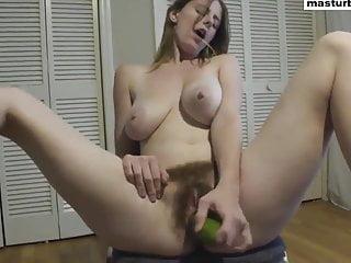 Hairy pussy fucks cucumber