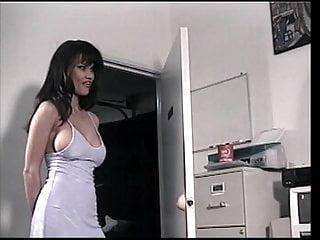 Brunette hottie blows cock in the office