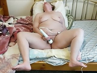 Giving herself an orgasm using a hitachi...