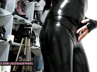 Jessi playing with dick in black latex catsuit...