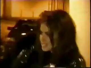 Carmen Electra in glitter suit