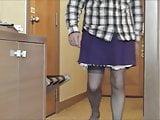 Dressing again in purple skirt slip knickers suspender belt
