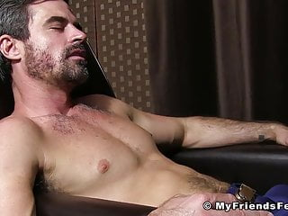 Handsome businessman has his feet licked and worshiped