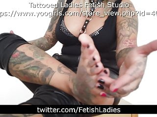 Tattooed Blonde Lady Shows Her Feet On Chair