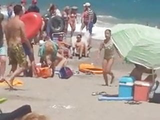 woman plays with herself on the beach