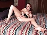 Sexy redheaded milf toys herself