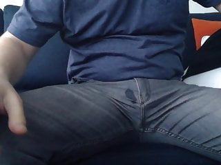 Guy rubs his small dick over his jeans and prematurely cums