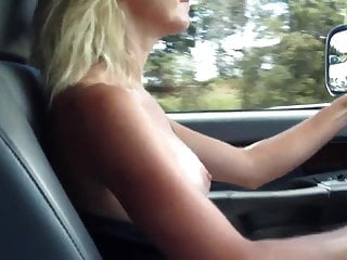 Busty milf driving topless on the highway...