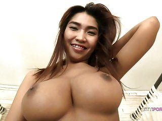 Big ole natural breasts on skinny Thai babe