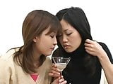 Two sexy Japanese girls spit in a glass and...