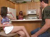 Monica suck in the kitchen.