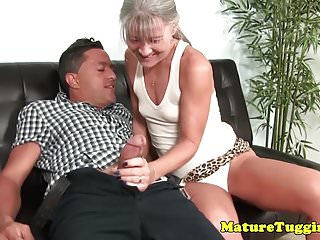 Smalltitted mature jerking on cock...