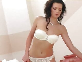 Helena teases in stockings a bra and heels