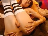 Tranny with big boobs plays with shaved cock and big balls