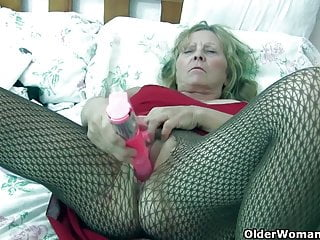 Granny with big tits wears pantyhose as she...