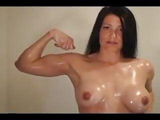 Oily Muscular Female Athlete